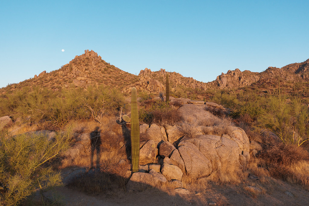 My shadow points towards the southern edge of the Granite Mountain with the moon about to set, the sun starting to rise, at McDowell Sonoran Preserve in Scottsdale, Arizona on October 3, 2020. Original: _CAM5292.arw