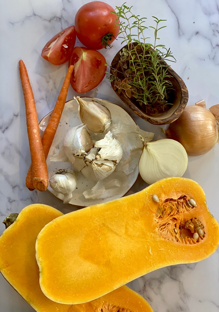 Seen here are all the ingredients needed for garlic and rosemary butternut squash soup!