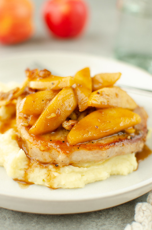 Apple Cinnamon Pork Chops - sauteed pork chops topped with soft cinnamon apples. Easy 30 minute dinner!