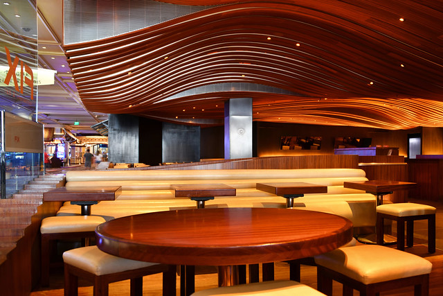 Las Vegas NV, USA 9-26-18 The Fix Restaurant & Bar at the Bellagio has a beautiful wooden ceiling with a contemporary design of curved lines in the shape of a wave that matches the color of the tables