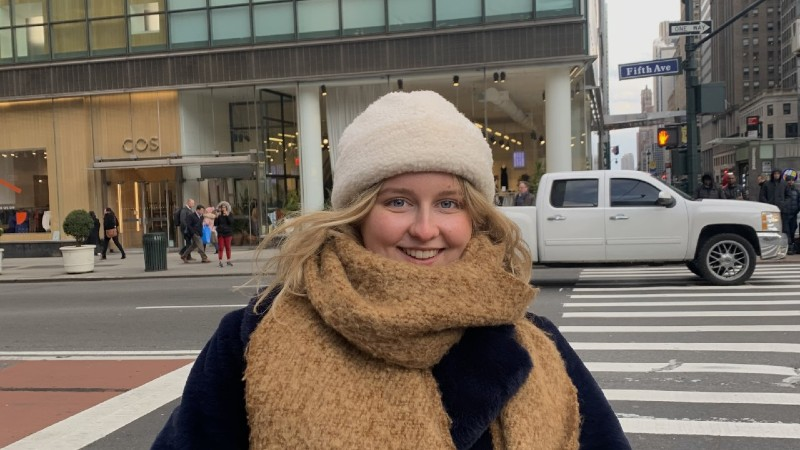Photo of Chloe by the side of the road on a Fifth Avenue in New York