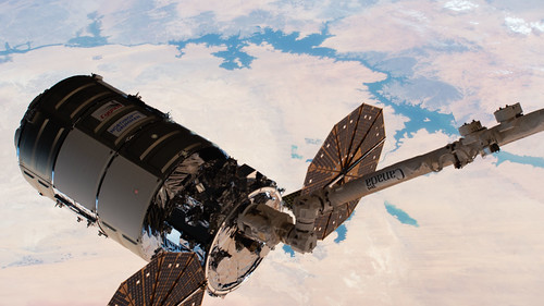 The Cygnus space freighter in the grips of the Canadarm2 robotic arm | by NASA Johnson