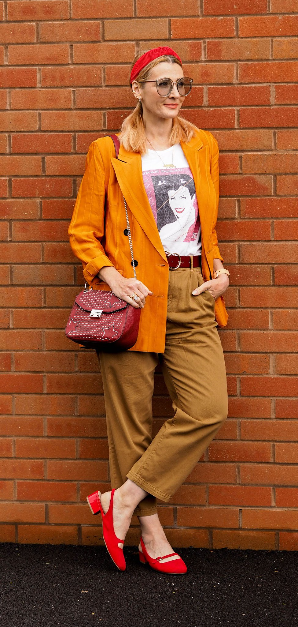 The Power of Accessories: A Blazer, T-shirt and Trousers Story (Catherine is wearing an orange blazer, brown relax fit trousers, a Duran Duran Rio album print t-shirt, red slingback shoes and red accessories) | Not Dressed As Lamb, over 40 style