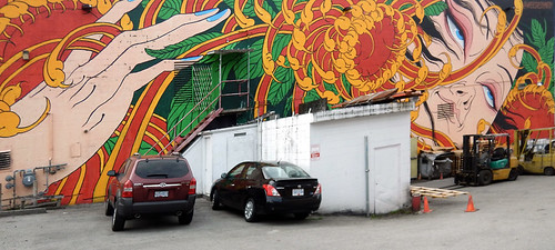 Bright mural of an exotic woman on the wall of a building in the Downtown Eastside of Vancouver, Canada