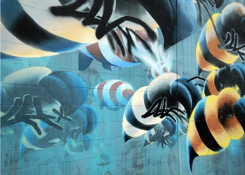 A mural of a swarm of bees on the wall of a building in the Downtown Eastside of Vancouver, Canada