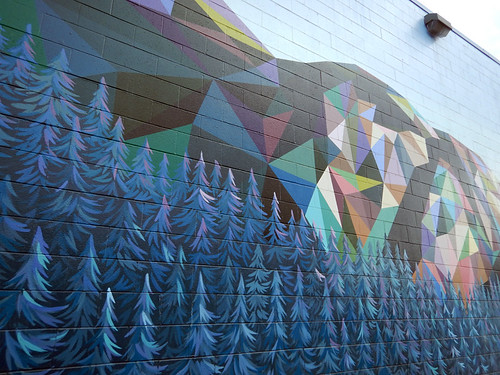 Mural of local mountains and trees on the wall of a building in the Downtown Eastside of Vancouver, Canada