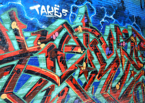 Bright graffiti on the wall of a building in the Downtown Eastside of Vancouver, Canada