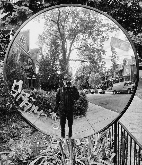 Another self-portrait in a round mirror