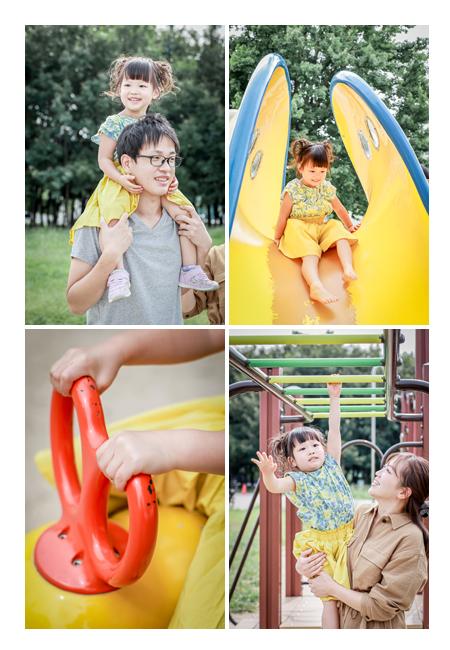 公園の遊具で遊ぶ女の子