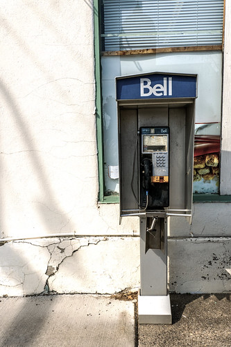 bell phonebooth vintage dated aging pushbutton wall disrepair tired
