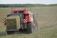 Tractor baling pea haulm