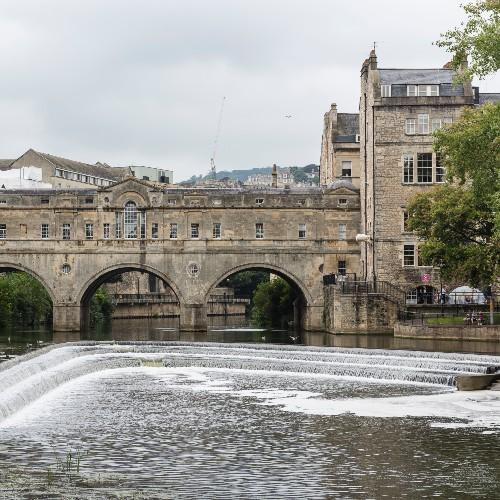 Bridge in Bath with stepped waterfall beneath.