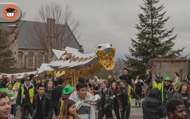 a lot of people bringing a golden dragon