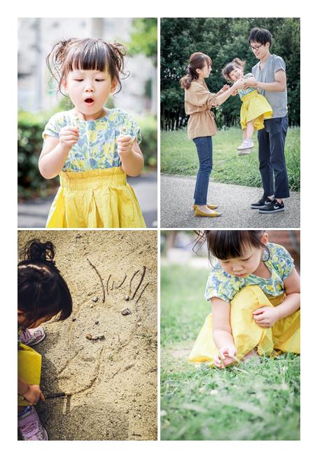 公園で遊ぶ親子 砂に絵を描く女の子