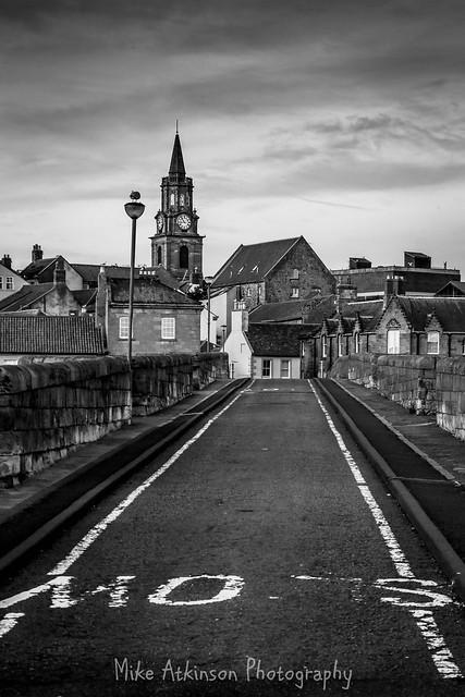 Crossing Berwick Old Bridge (Mono Portrait).