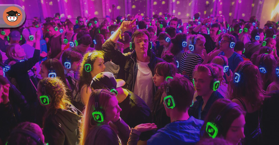 young people dancing at a party in headphones