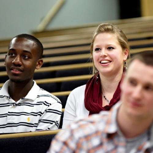 Two students sitting in a lecture