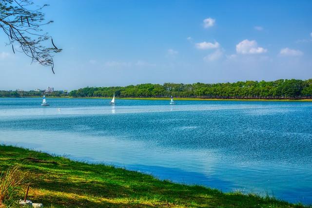 Nong Bon lake recreational area with small sailing boats in Bangkok, Thailand