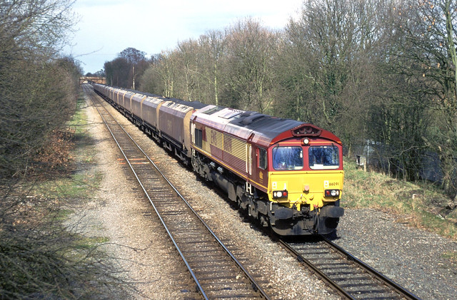 EWS Class 66, No. 66 091 drifts along the Lea Marston avoiding line with an MGR coal train bound for Ironbridge or Rugeley power stations. February 2004.