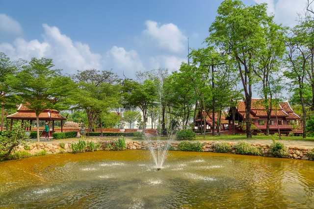 Pond with fountain in Muang Boran (Ancient City) open air museum in Samut Phrakan near Bangkok, Thailand