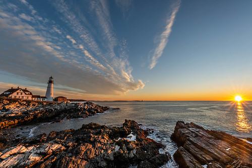 artlens sigma sunrise portland head lighthouse landscape yellow blue rocks clouds maine travel roadtrip nikon d750 tamron