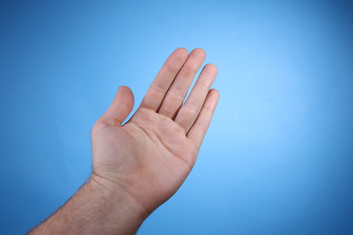 Palm of a man's hand isolated on blue background