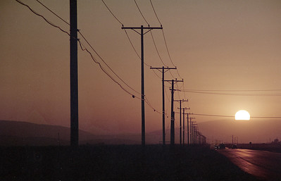 smoky sun sets on the Pearblossom Highway