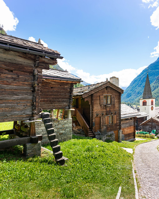 Wooden shed on Pilars with tiny stairs leading to the entrance in Swiss village