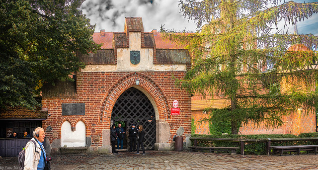 Security attending the main entrance and moat to the Malbork Castle, Malbork, Poland. 045-Edita