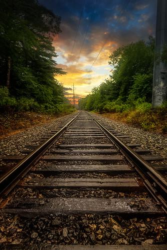 northkingstown rhodeisland unitedstatesofamerica traintracks train tracks ri sunset rain weather d850 nikon newenglandlegends madewithluminar on1pics hdr raw leading lines