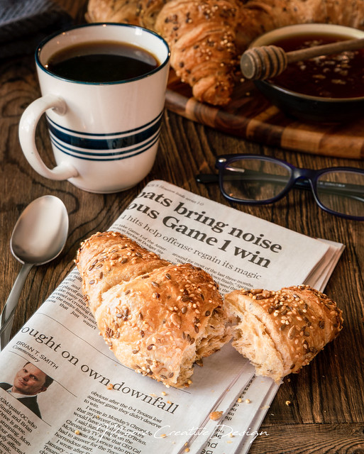 Croissant and Newspaper