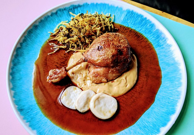 Confit duck leg with caramelised cauliflower puree, pickled king oyster mushroom and straw potatoes