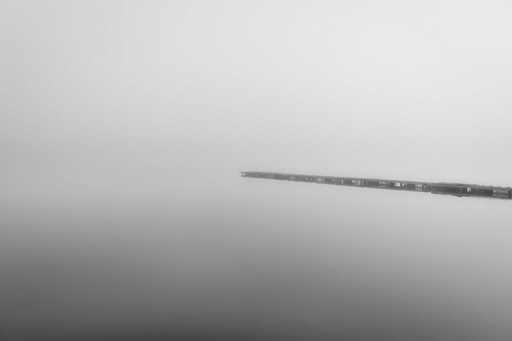 Jetty on a Foggy Lake
