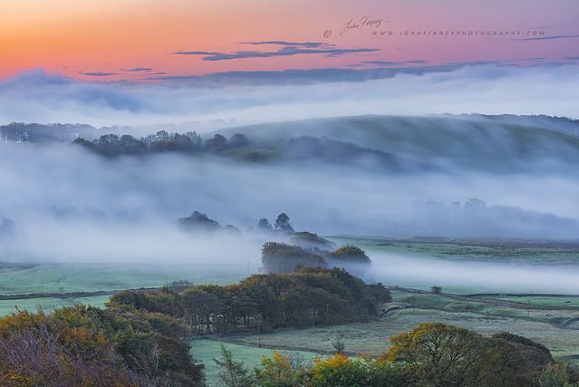 Autumn mists at sunrise