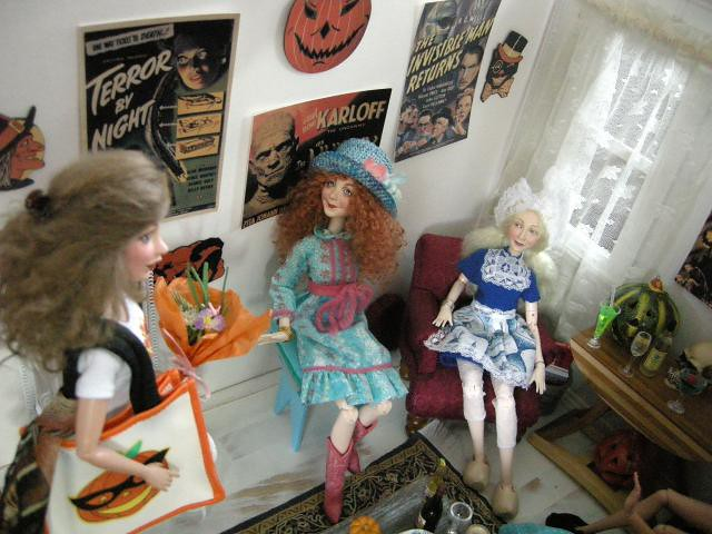 Jane, sitting on the right, is a Little Dutch Girl, and Molly, sitting to her left, is doing a retro fashion thing.