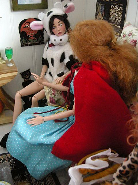 Kai is a cow, and Angelique is Little Red Riding Hood.