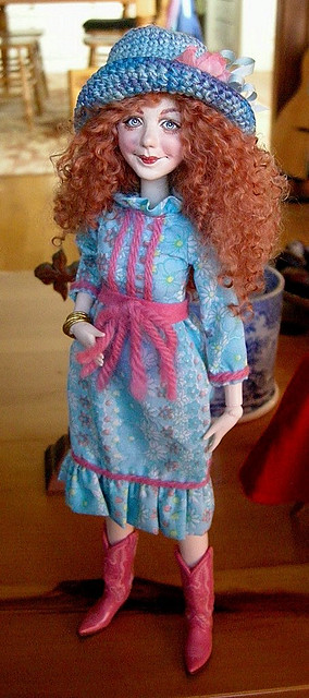 Molly, whose hair is now almost as light as Jane's.  I'm not sure what does it, but red headed dolls with mohair hair just can't keep the color in their hair here.