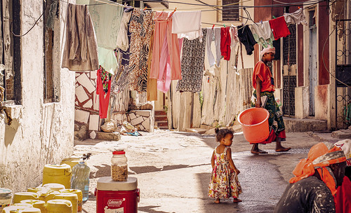 Laundry with mother and child in Mombasa, Kenya. Photographer Spotlight: Mathias Falcone