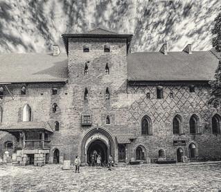 Black and white photo of inside the main quad of the Malbork Castle, Malbork, Poland.  055-Editbw