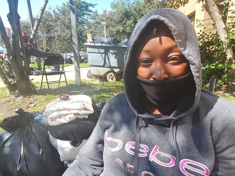 Monique Frederick, a Harriet Tubman Women's Shelter resident, sits outside the building during a deep clean on Sept. 22.