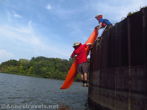 Lowering kayaks off of one the fishing platforms in Turning Point Park, Rochester, New York