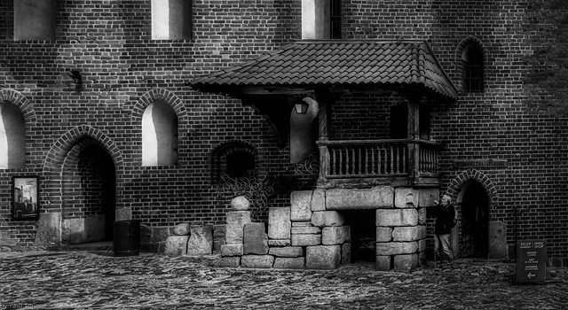 Black and white photo or interesting architecture inside the main quad of the Malbork Castle, Malbork, Poland.  060-Editbw