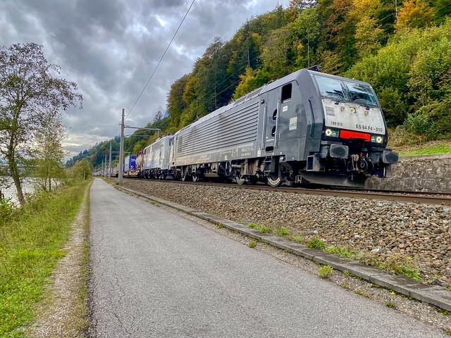 Freight train passing the river Inn near Kufstein in Tyrol, Austria