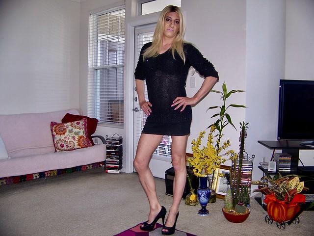 Amanda Standing in Living Room in Black Dress