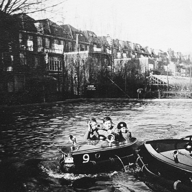 Harding Klimanek and Kien family children in mini-boats in a pond in The Hague, 1934