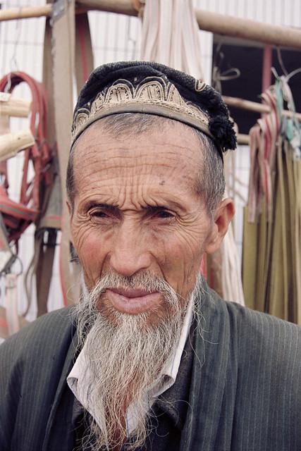 Uyghur man at Kashgar Sunday Market, Xinjiang Region, China