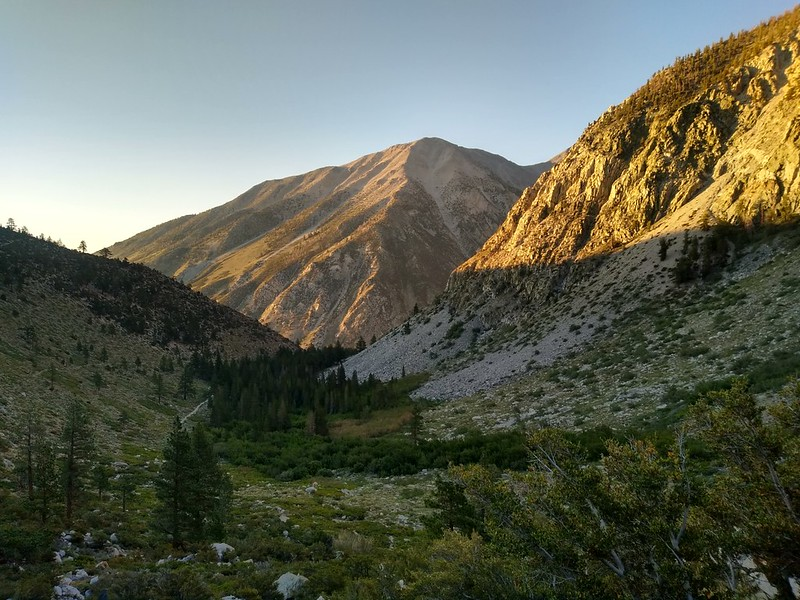 The sun is rising and Kid Mountain is lit, while First Falls remains in shadow below us
