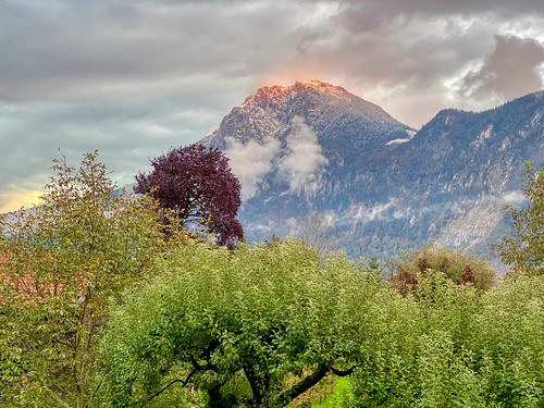 Zahmer Kaiser mountain range with first snow in the evening sunlight seen from Kiefersfelden in Bavaria, Germany | by UweBKK (α 77 on )