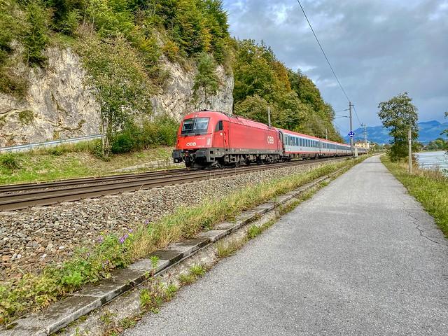 ÖBB passenger train passing the river Inn near Kufstein in Tyrol, Austria