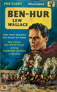 """""""Ben Hur"""" by Lew Wallace. Pan Giant X-32 (1960). British paperback edition. Third printing. Movie tie-in. Cover portrait of Charlton Heston and the Chariot Race by O'Connell."""